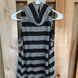Sleeveless sweater with cowl neck.